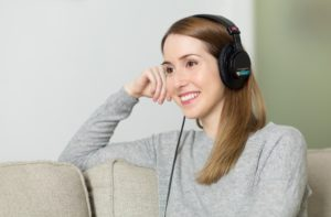 Girl listening to music, which is a relaxation technique used by people looking to buy mobility equipment online, with pulmonary fibrosis
