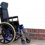 A wheelchair outside a house, as supplied by 1st Step Mobility wheelchair suppliers